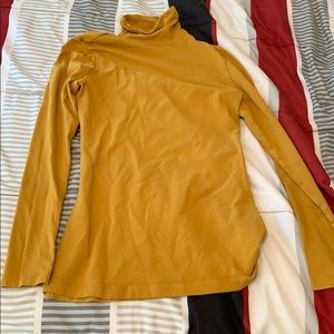 Thin yellow turtleneck top